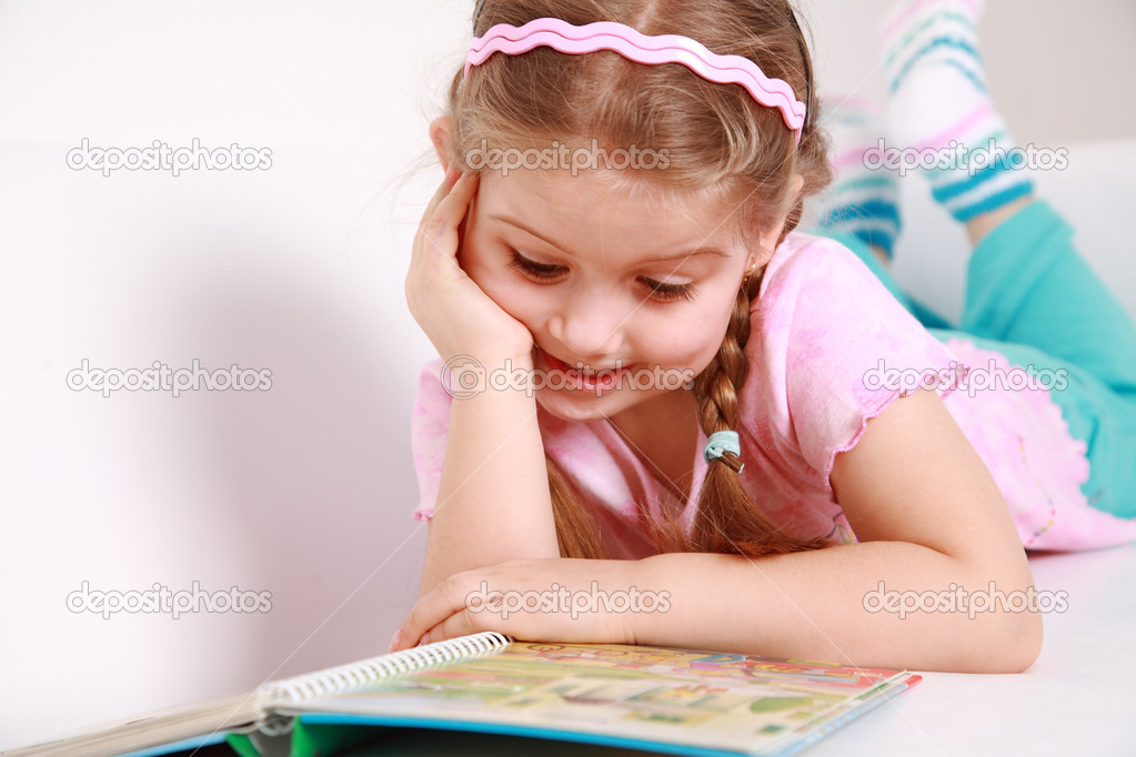 Cute little girl reading a book — Stock Photo #2274631