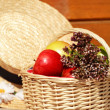 Basket with apples and herbs - Stock Photo