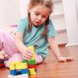 Adorable girl playing with blocks — Stock Photo
