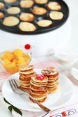 Sweet pancakes with pancake maker — Stock Photo