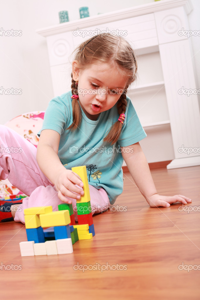 Adorable girl playing with blocks  Stock Photo #2287225