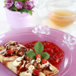 Delicious crepes with strawberry sauce and chocolate — Stock Photo #2306443