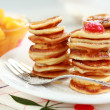 Sweet mini pancakes - Stock Photo