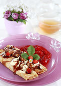 Delicious crepes with strawberry sauce and chocolate — Stock Photo