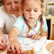 Grandma and grand-daughter painting — Stock Photo
