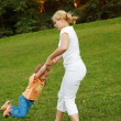 Lot of fun with mother in the park — Stock Photo