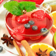 Winter fruit tea with fresh fruits - Stock Photo