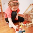 Playing with doll's house - Stok fotoğraf