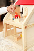 Playing with doll's house — Stock Photo