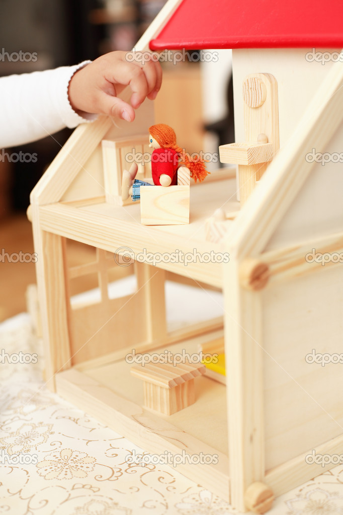 Playing with doll's house - detail of hand — Stock Photo #2333594
