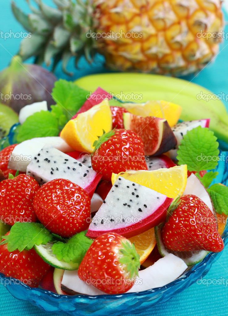 Delicious fresh fruits in bowl as dessert  Stock Photo #2334624