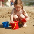 Girl playing on the beach — Stock Photo #2390808