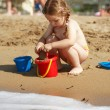 Girl playing on the beach — Foto de Stock