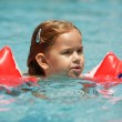 Little girl swimming — Stock Photo #2390841