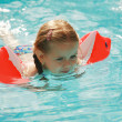 Little girl swimming — Stock Photo #2390845