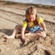 Girl playing on the beach — Stock Photo #2390869