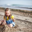 Girl playing on the beach — Stock Photo #2390881