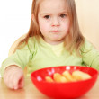 Beautiful small girl eating — Stock Photo