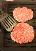 Grilling hamburgers — Photo