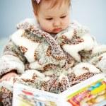 Cute baby reading — Stock Photo