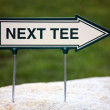 Stock Photo: Next Tee Sign