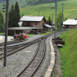 Railroad tracks through a village — Stock Photo