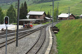Railroad tracks through a village — Stok fotoğraf