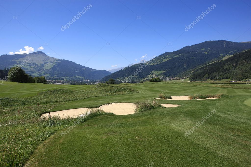 Golf Course in front of a beautiful landscape scenery  Stock Photo #2456291