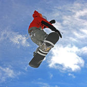 Snowboarder jumping high — Stockfoto