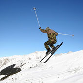 Skiing militarist — Stock Photo