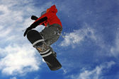 Snowboarder jumping high in the air — Stock Photo