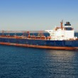 Large cargo ship in a harbor — Stock Photo