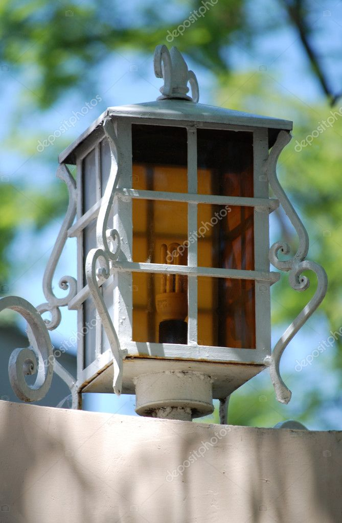 Antique style street lantern painted white and mounted on a wall — Stock Photo #2512233