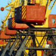 Cargo cranes lined up in sea port — Stock Photo