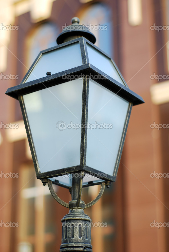 Beautiful antique style street lantern in front of building — Stock Photo #2520539