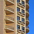 Residential building with balcony rows — Stock Photo