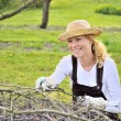 Young woman cleaning tree limbs — Stock Photo #2185439
