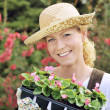 Woman with container-grown plants — Stock Photo