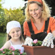 Royalty-Free Stock Photo: Mother and daughter gardening