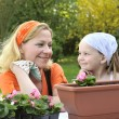 mother, daughter having gardening time — Stock Photo