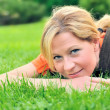 Young woman relaxing on the grass — Stock Photo