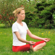 Young woman doing yoga - meditation — Foto Stock