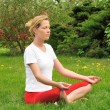 Young woman doing yoga - meditation — Stockfoto