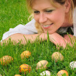 Young woman and easter eggs — Stock Photo