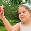 Stock Photo: Little girl holding Easter egg