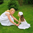 Young mother and daughter playing — Stock Photo #2266075