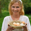 Stock Photo: Young woman and Easter eggs