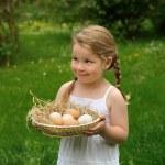 Little girl holding eggs — Stock Photo #2269723