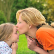 Mother is kissing her daughter — Stock Photo #2303484