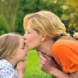 Mother is kissing her daughter — Stock Photo